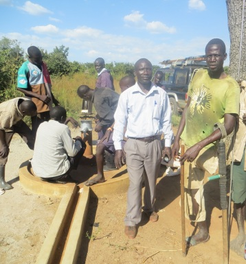 alex-and-eng-tom-infront-of-barabolo-borehole-being-repaired