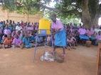 A pupil demonstrates handwashing skills learn in the WASH sensitization